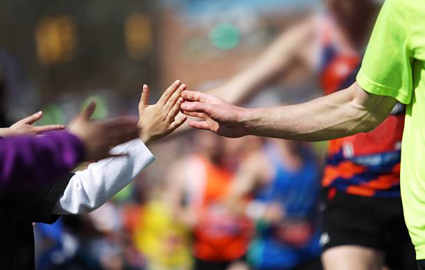 high five - boston marathon stock photos and pictures