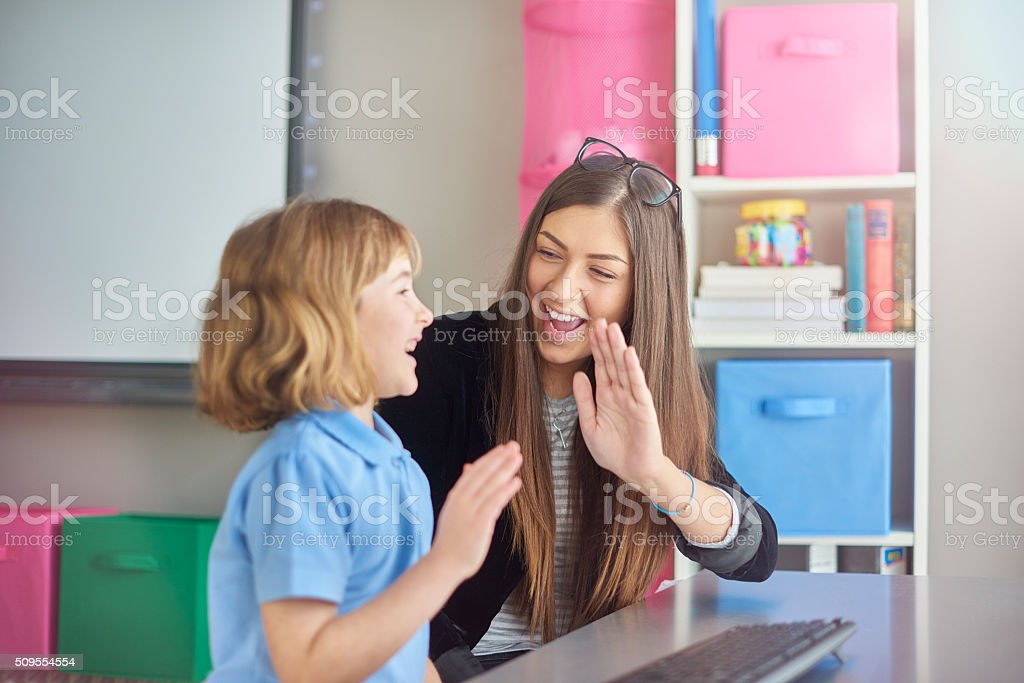 High five schoolgirl in ICT class stock photo