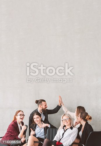 istock high five thumb up business team celebrate success 1140058204