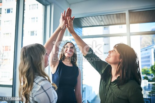 1031394114istockphoto High five to achieving all our business goals 1127300064