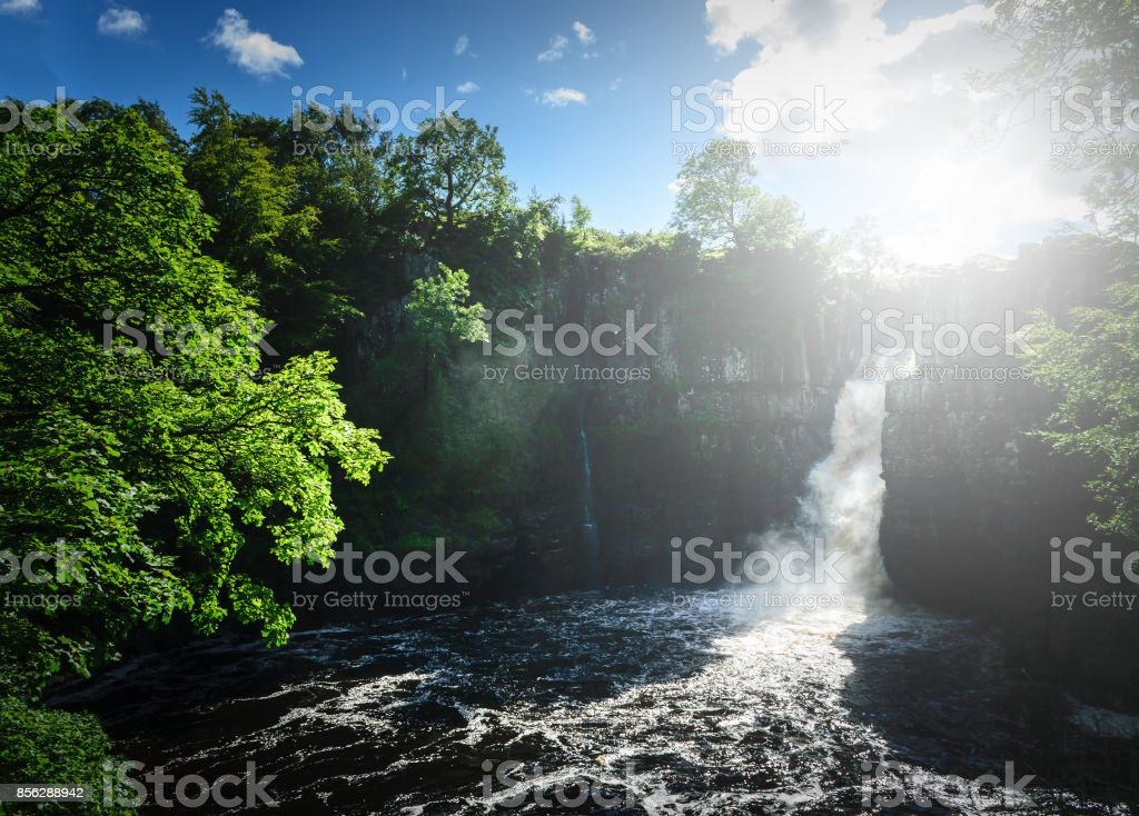 High Force Waterfall views from the south bank of the River Tees on the Pennine Way in woodland, UK. stock photo