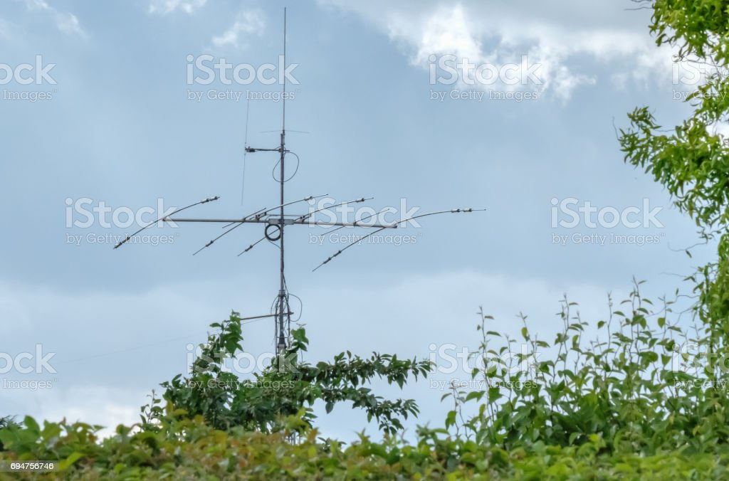 High frequency radio mast seen erected in a rural location. stock photo