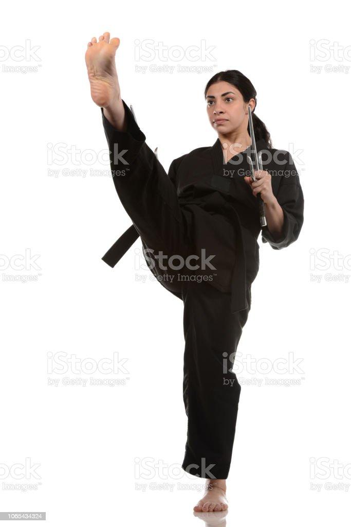 High Front Kick with Sais stock photo