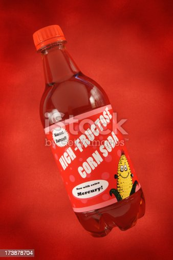 Humorous fake soda bottle poking fun at how unhealthy and unnatural high fructose corn syrup is.  This composition is designed to resemble a cheesy soda advertisement, with copy space.