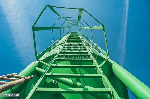 1048837520 istock photo High green metal ladder on the construction site. Original view 872365348