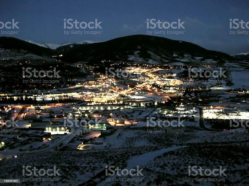 High ground view of Breckenridge during the night and snow stock photo