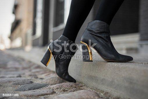 High heel boots in city