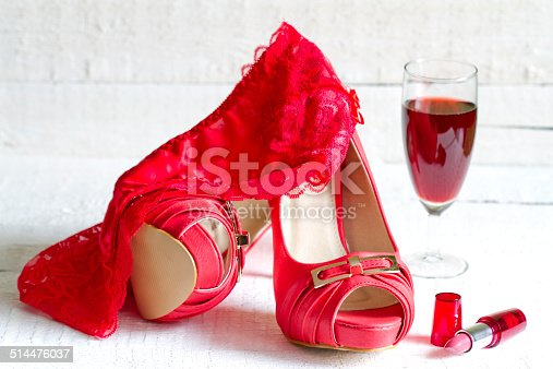 istock High heels and red g-string abstract concept 514476037