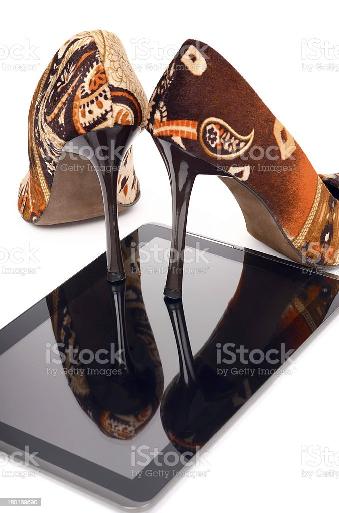 High heels and tablet. royalty-free stock photo