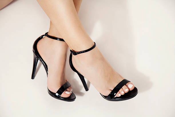 high heels - human foot stock photos and pictures