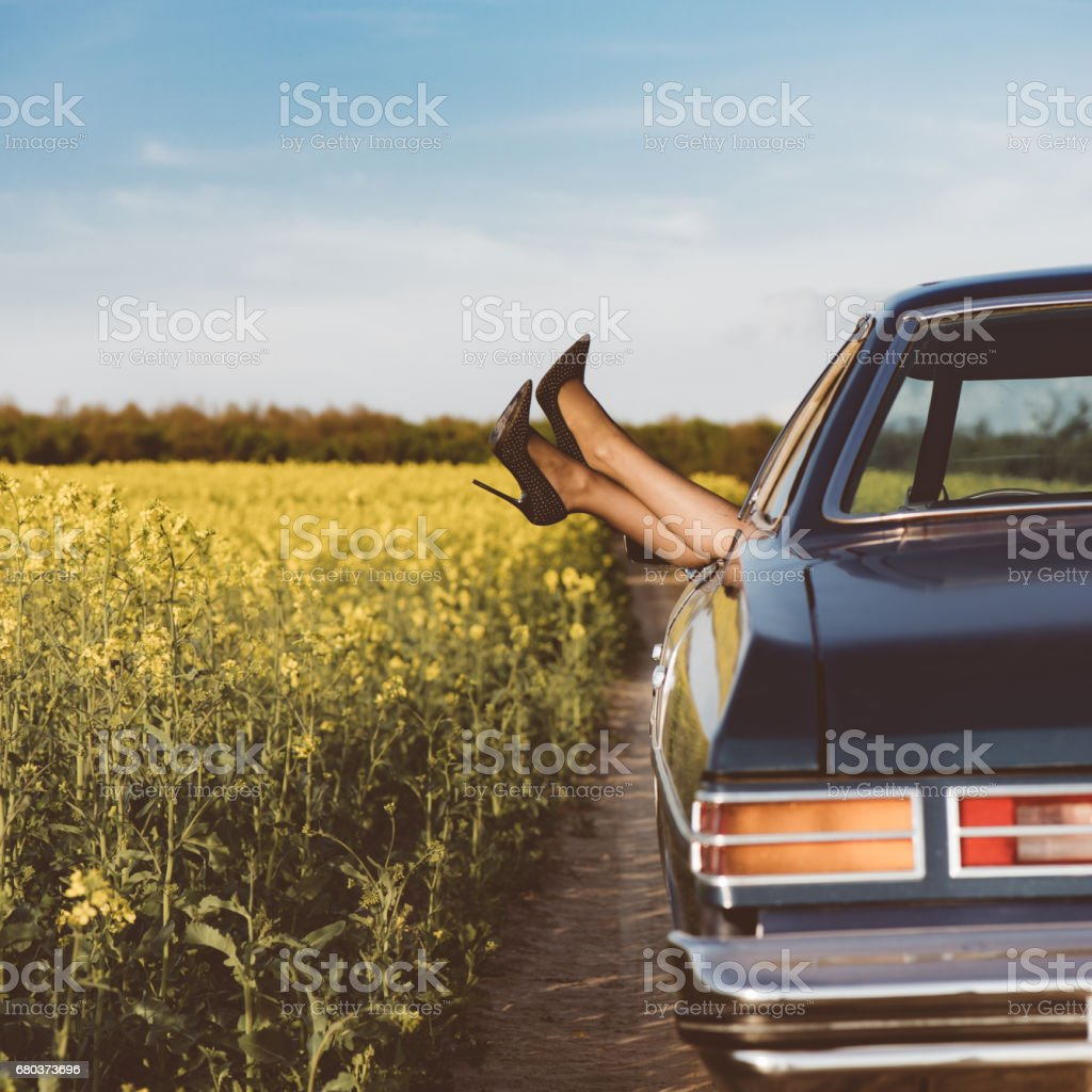 High heels shoes out of car window royalty-free stock photo