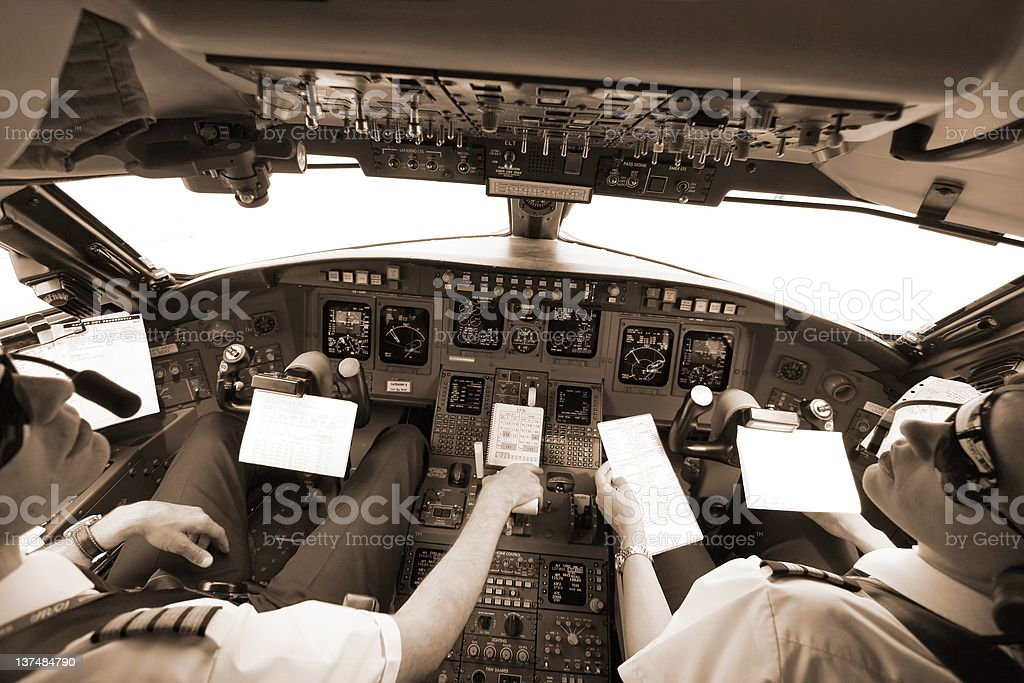 High in the sky with young pilots royalty-free stock photo