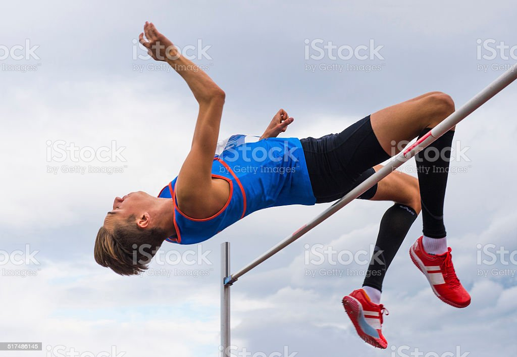 High jump competition in cloudy wheather stock photo