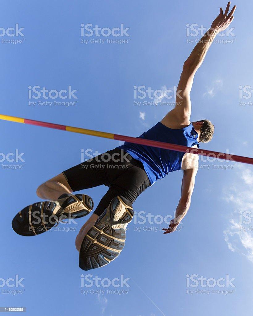 High jump over the bar stock photo