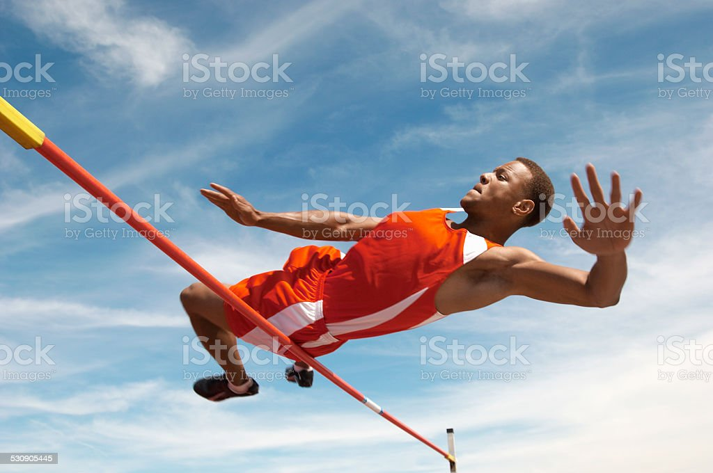 High Jumper Clearing the Bar stock photo
