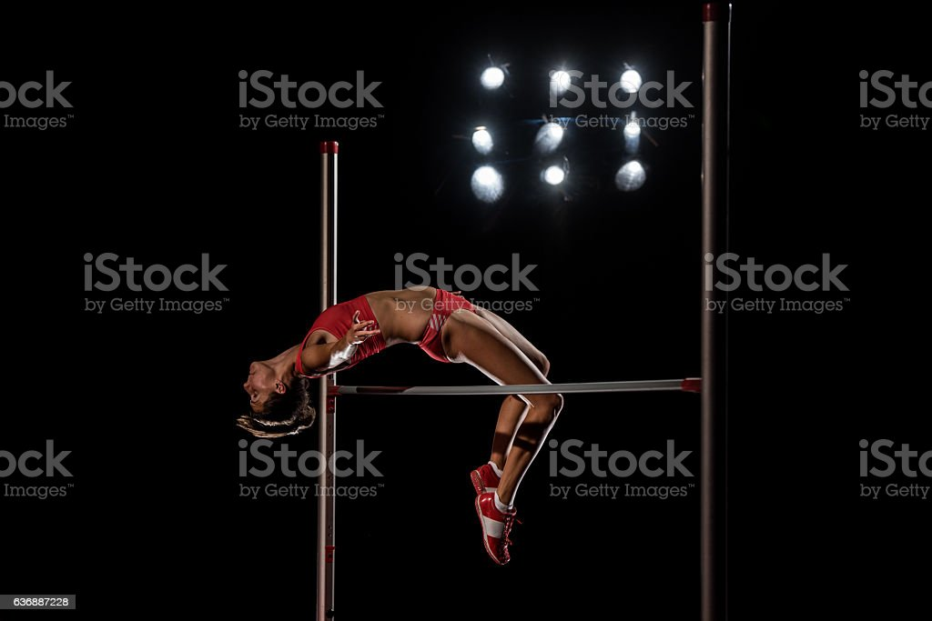 High jumper performing stock photo