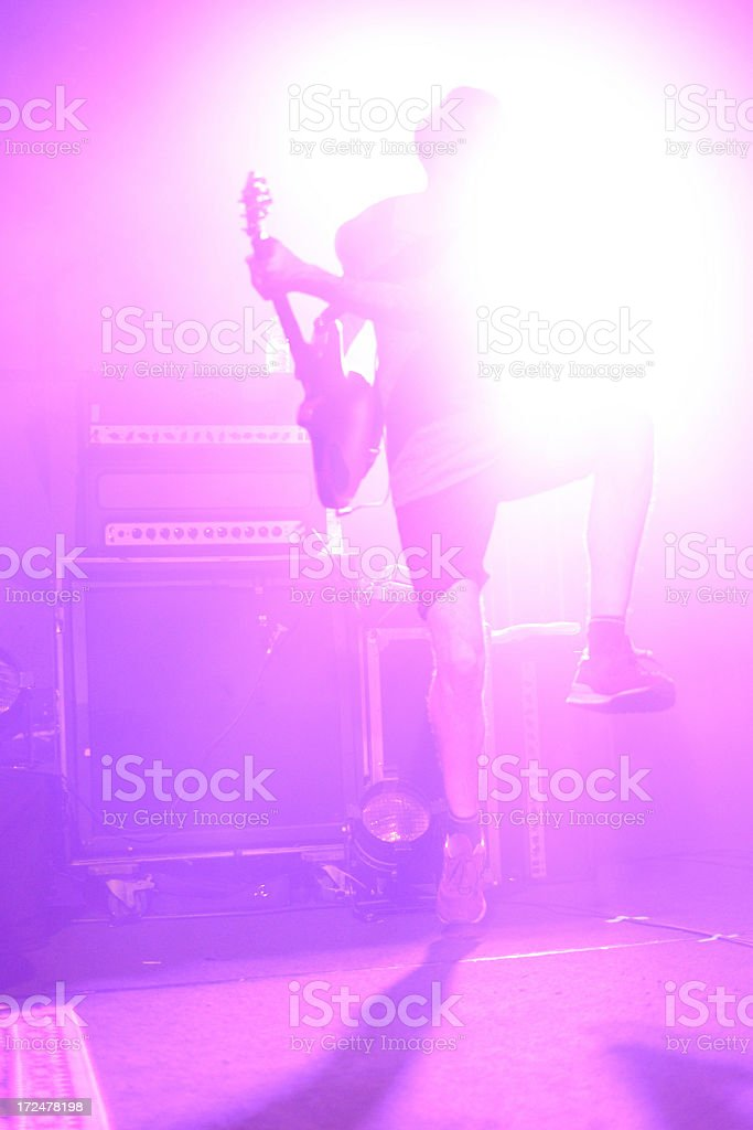 high jumping guitar on a stage stock photo
