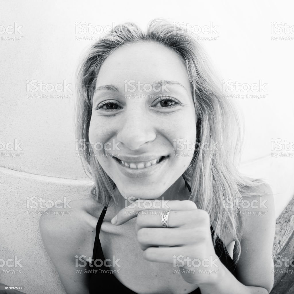 High key portrait of a smiling woman - monochrome royalty-free stock photo