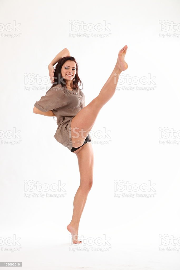 High kick ballet dance move by beautiful young woman stock photo