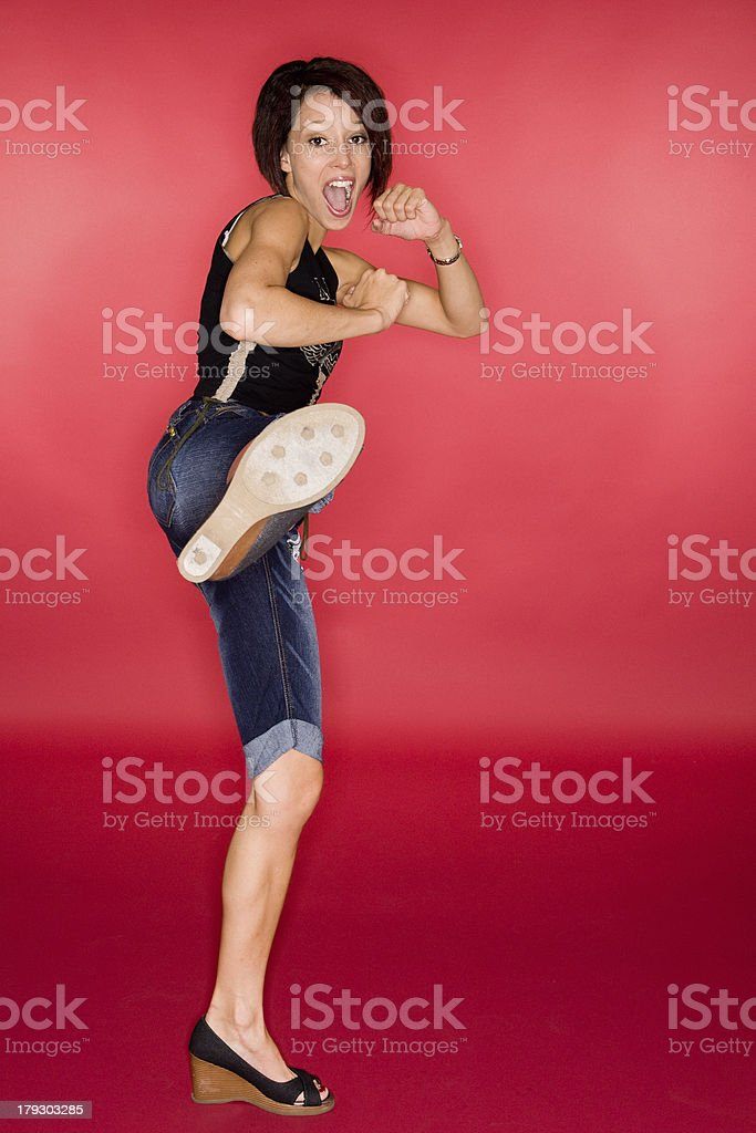 High Kick on Red stock photo