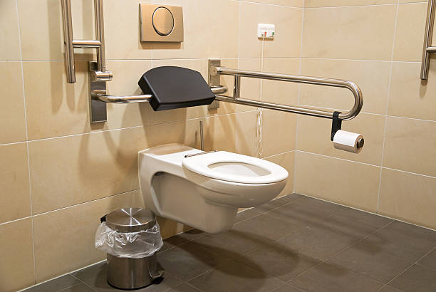 A high level toilet with a handrail for disabled people stock photo