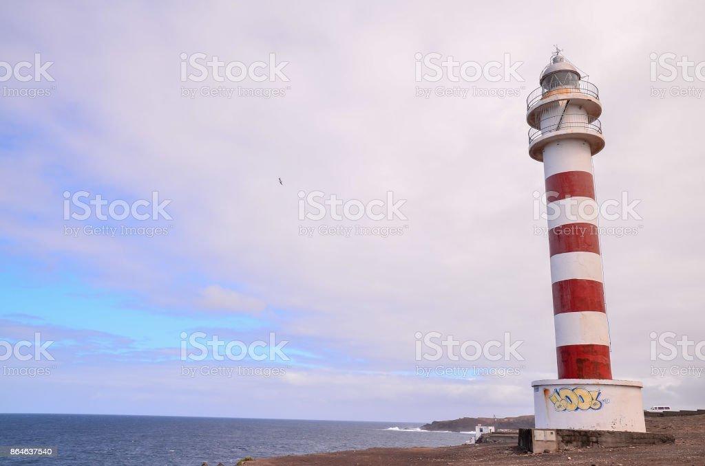 High Lighthouse near the Coast stock photo