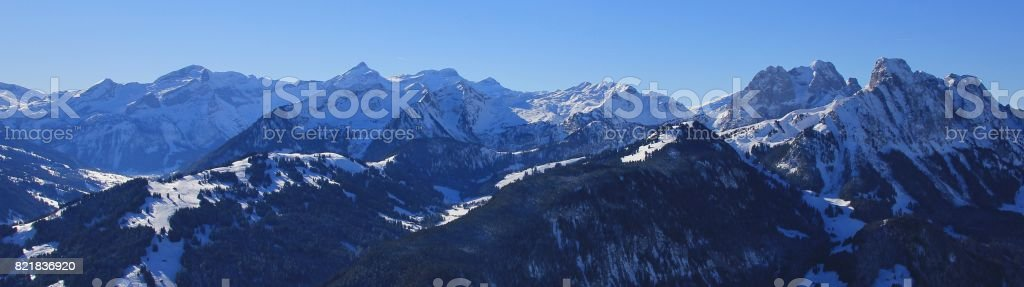 High mountain Oldenhorn and other peaks. Winter landscape. stock photo