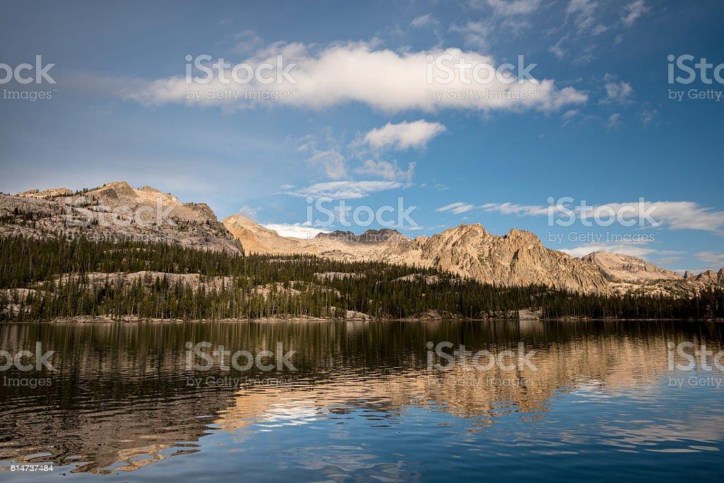 High mountain range reflection in lake stock photo