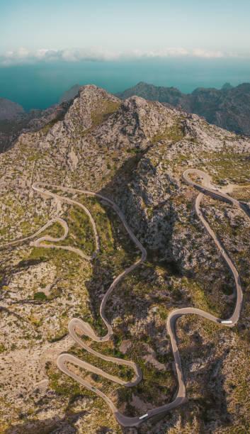 High mountain serpentine road vertical drone photo. Mallorca, Spain. stock photo