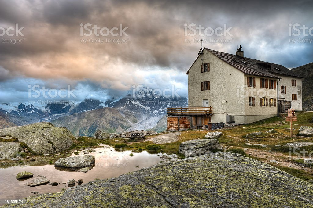 High mountain shelter at sunset royalty-free stock photo