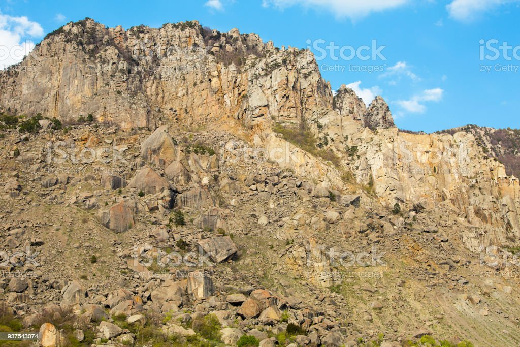 high mountain slope covered with small stones painted large expedition to the mountains stock photo