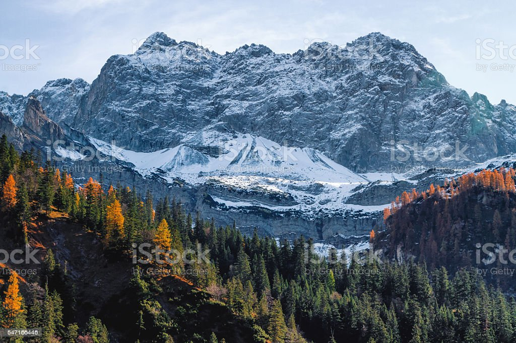 High mountains covered with snow in late autumn season. stock photo