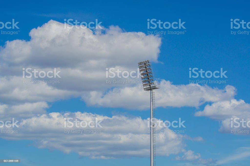 high pole Spotlight Stadium lights with blue sky background. stock photo