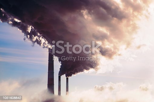 istock High pollution from coal power plant. Smoking chimney. 1051608842