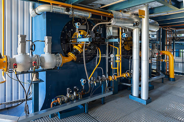 high power boiler burner - cogeneration plant stock photos and pictures