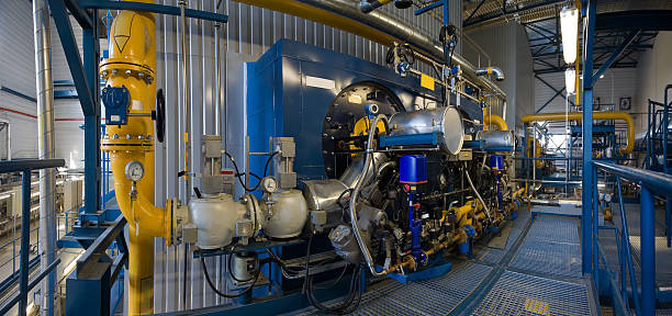 high power boiler burners - cogeneration plant stock photos and pictures
