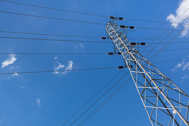 High power lines on a sky background stock photo