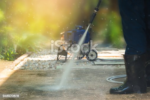 istock High pressure cleaning, side view. 948920828