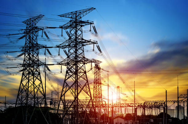 high pressure wire tower at sunset at dusk - fuel and power generation stock photos and pictures