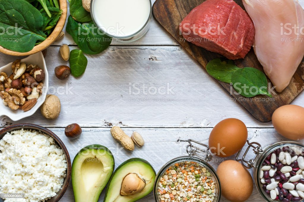 High protein food - chicken, meat, spinach, nuts, eggs, beans and cheese stock photo