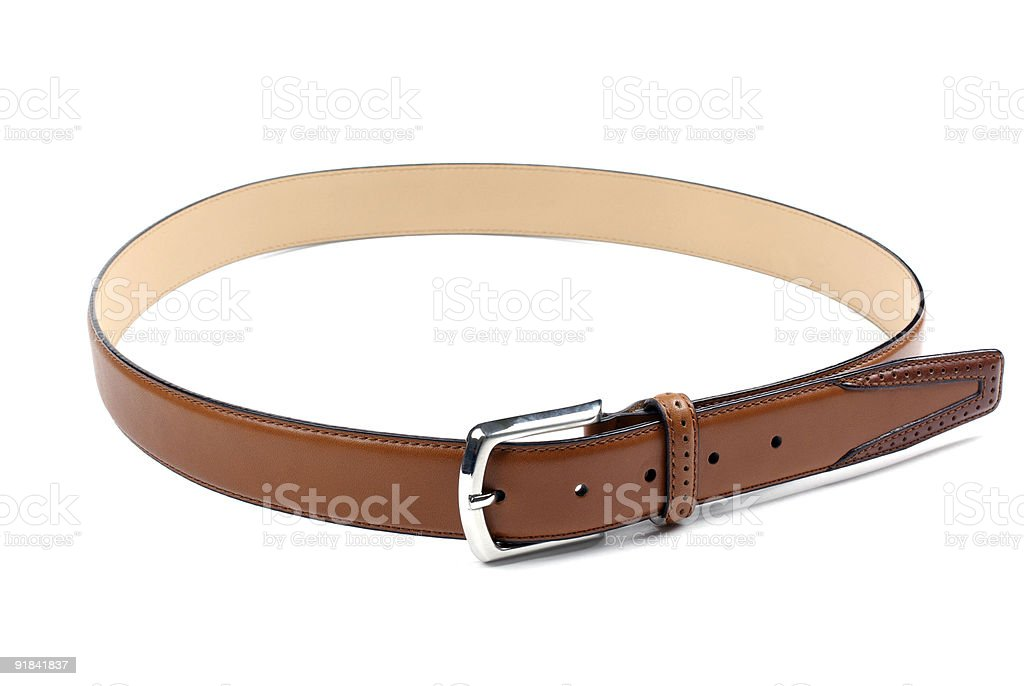 High quality brown leather belt isolated on white background. royalty-free stock photo