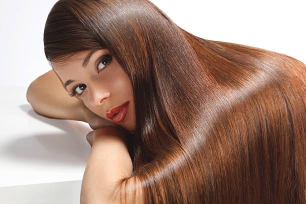 high quality image. woman with smooth hair - lang haar stockfoto's en -beelden