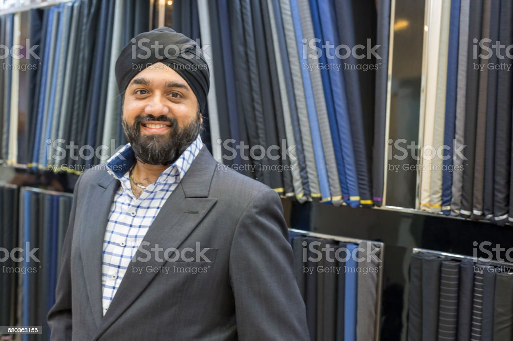 High Quality Sikh Tailor in His Luxury Suit Shop royalty-free stock photo