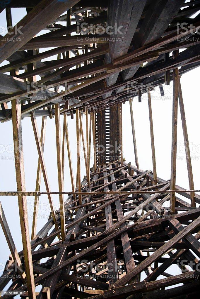 High railway bridge made of wooden typesetting beams stock photo