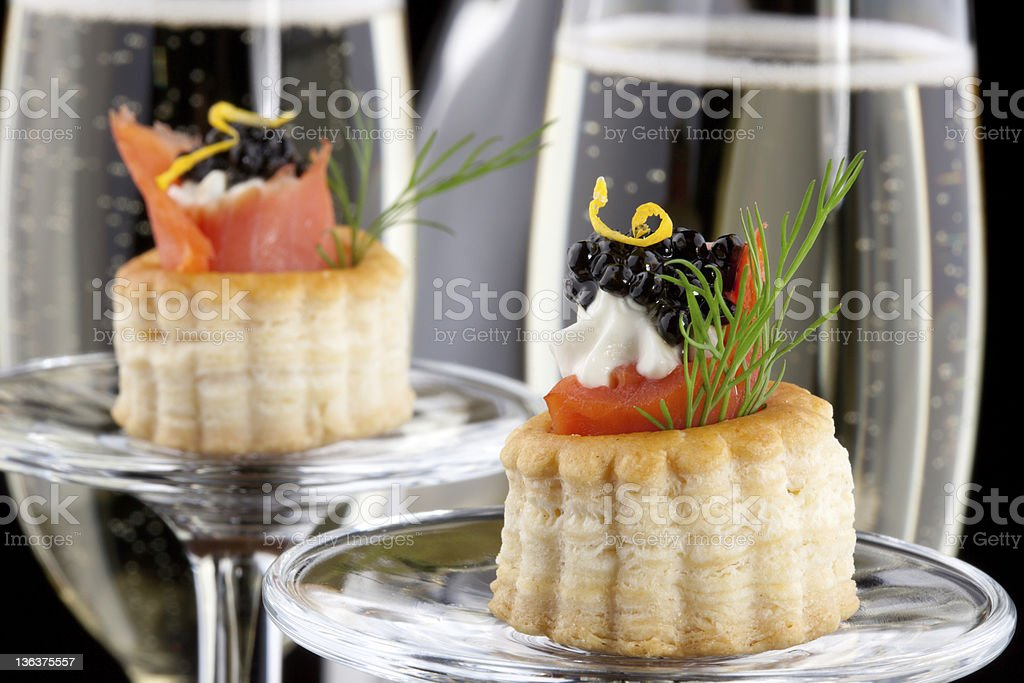 High res picture of black caviar canape and champagne stock photo