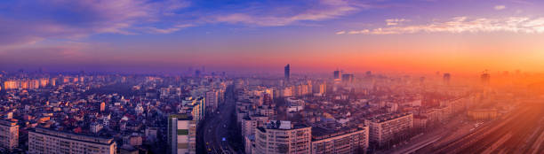 High resolution beautiful panorama in the morning over the city with very vibrant colors multiple exposure shot with many architectural details stock photo