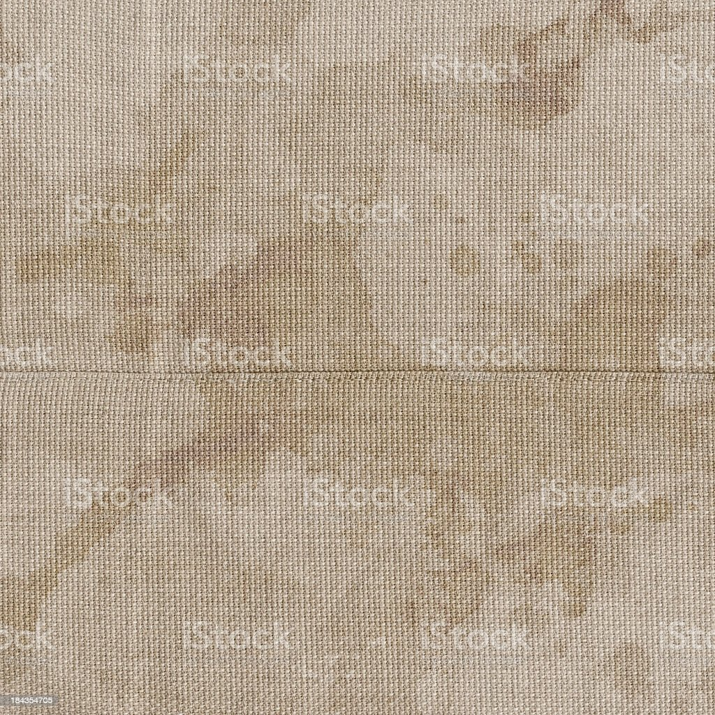 High Resolution Beige Polyester Fabric Mottled Blotted Grunge Texture royalty-free stock photo