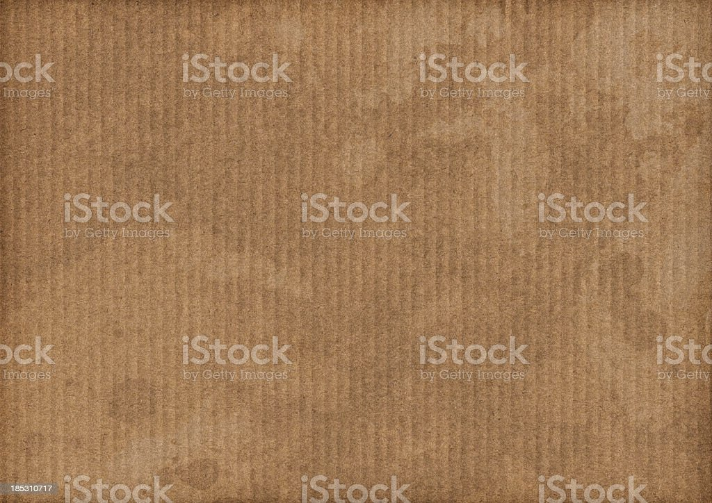 High Resolution Brown Corrugated Cardboard Stained Dappled Grunge Texture royalty-free stock photo