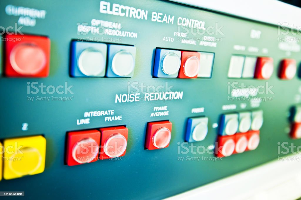 High Resolution Console In Master Control Room - Electron Beam Control & Noise Reduction Buttons royalty-free stock photo