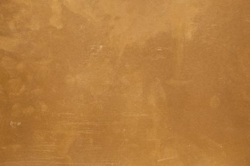 macro acid golden metal grunge background.